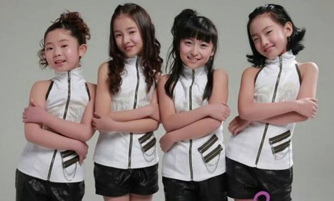 Nancy (second from left) as a part of Cutie Pies