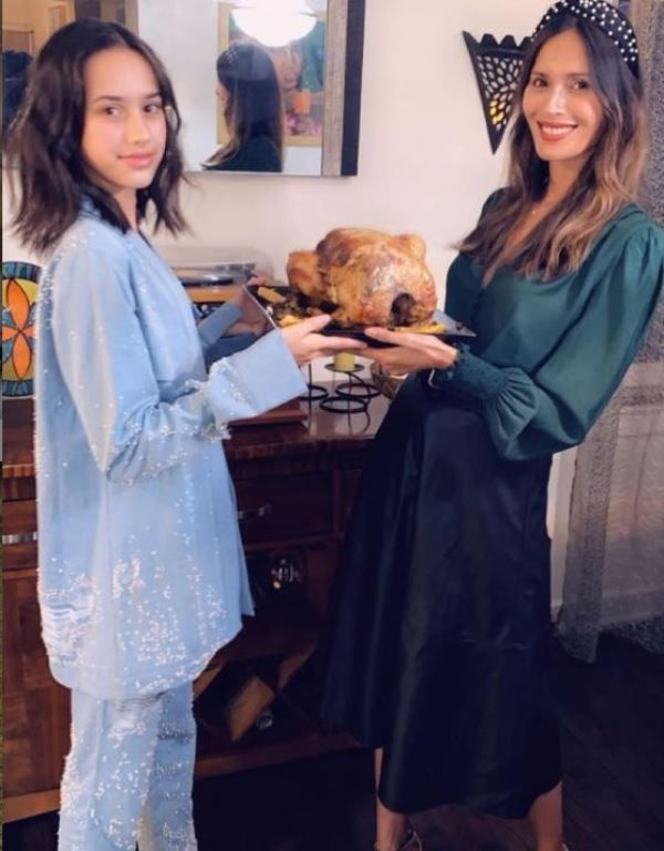 Ujjwala Raut showing a baked turkey dish in her hand