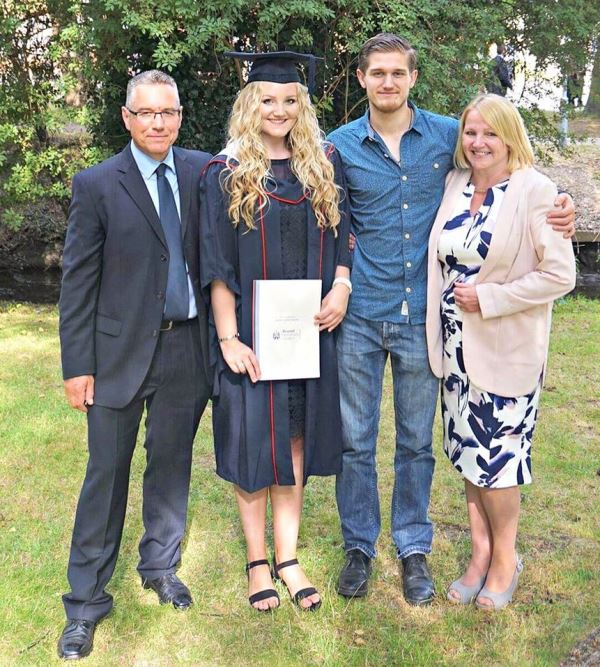 Adam Hugill with his family