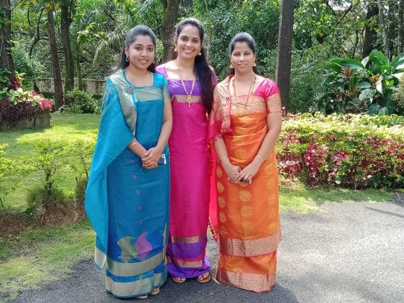 DC Annies Kanmani Joy (in the middle), SP Suman D Pennekar ( right), and ZP CEO K Lakshmi Priya (left) in traditional Kodava dress in Madikeri Dasara event