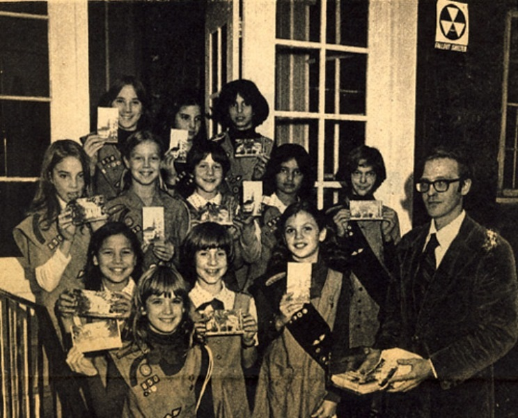 In a 1977 photo, Girl Scout Troop 850 promotes sales of postcards for the local historic jail. Lahiri is in the second row from the top, second from right