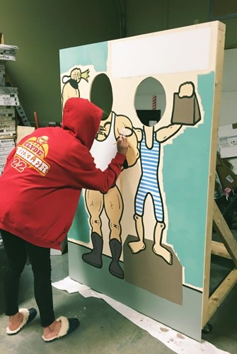 Kristin Taylor working on a face-in-hole board