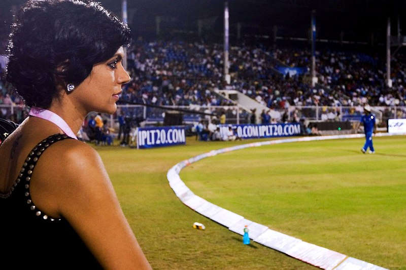 Mandira posing on the cricket playground while working as a cricket host