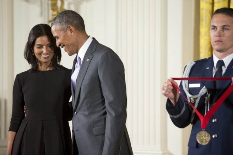 President Barack Obama awards the 2014 National Humanities Medal to author Jhumpa Lahiri of New York during a ceremony in the East Room at the White House in Washington, USA