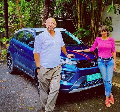 Raj Kaushal with his wife and car