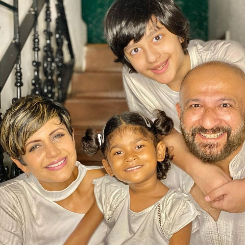 Raj Kaushal with his wife and children