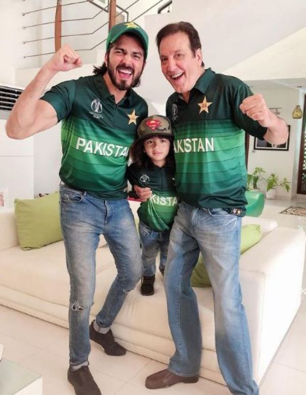 Shahzad Sheikh with his father and son wearing the Pakistani cricket team jersey