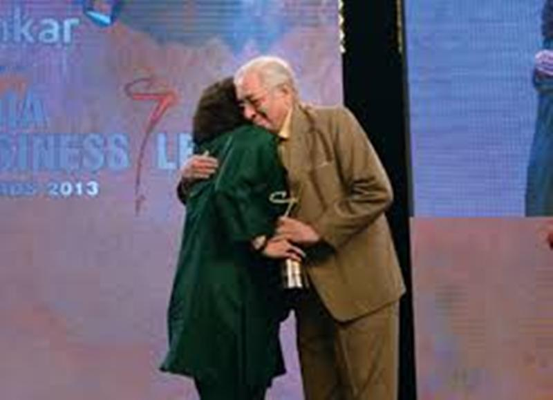 Zia Mody while receiving an award from her father, Soli Sorabjee, in 2013