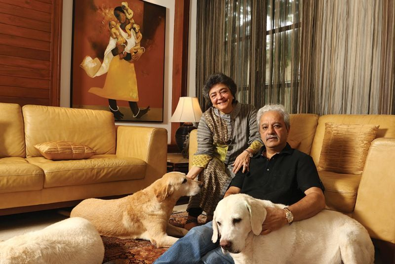 Zia with her pet dogs and husband, Jaydev Mody