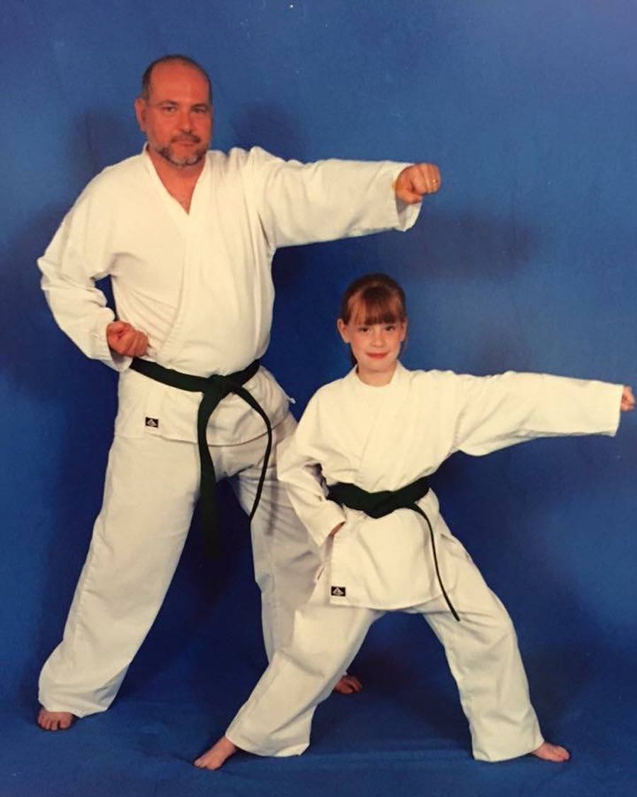 A childhood picture of Hayley while practicing Taekwondo with her father
