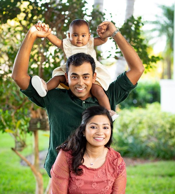 Anirban Lahiri with his wife and daughter