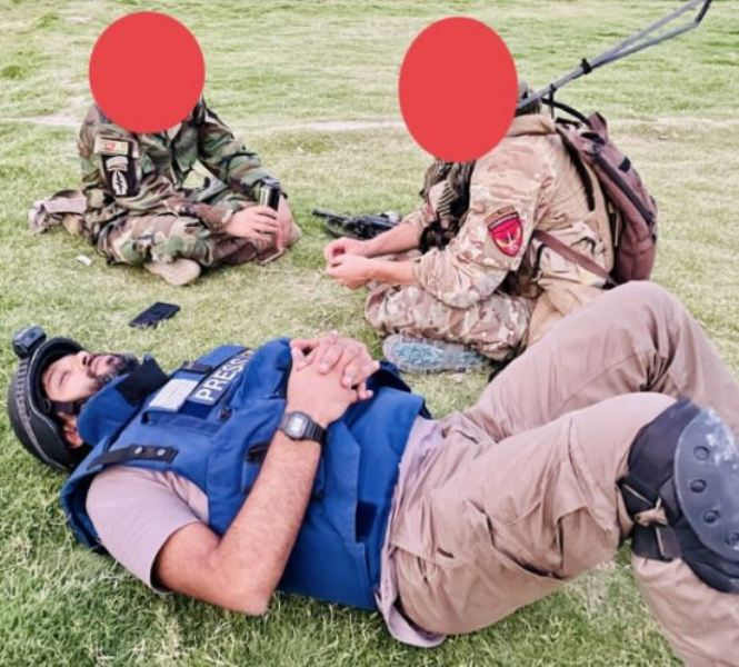 Danish while taking some rest with Afghan troops on 13th July in Afghanistan