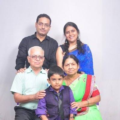 Dr Vikas Divyakirti with his parents, wife, and son