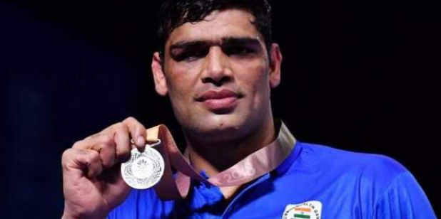 Satish Kumar with a silver medal at the 2018 Commonwealth Games