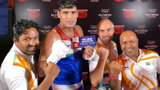 Satish Kumar with the ticket to 2020 Tokyo Olympics