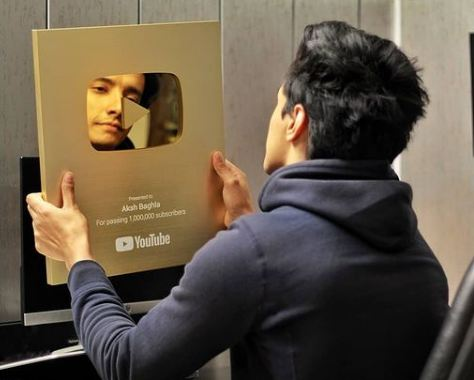 Aksh Baghla with his YouTube Gold Play Button