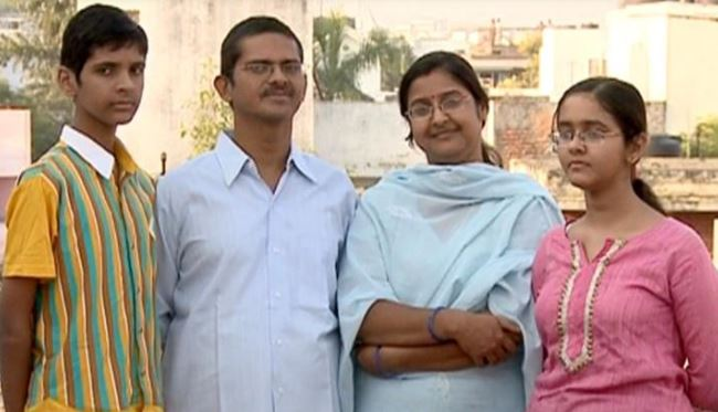 Amitabh Thakur with his wife and children
