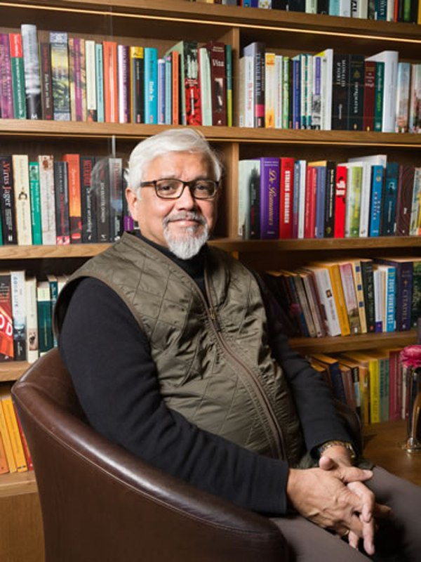 Amitav Ghosh while sitting in his library