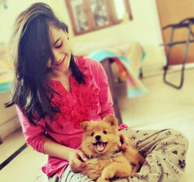 Avani with her pet dog