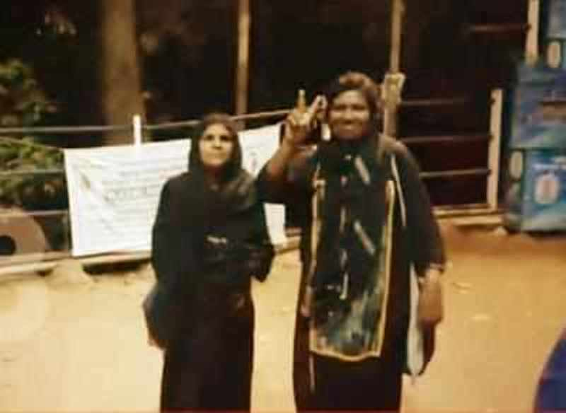 Bindu Ammini and Kanakadurga while showing victory sign after their successful entry into the Sabarimala Ayyappa temple in 2019