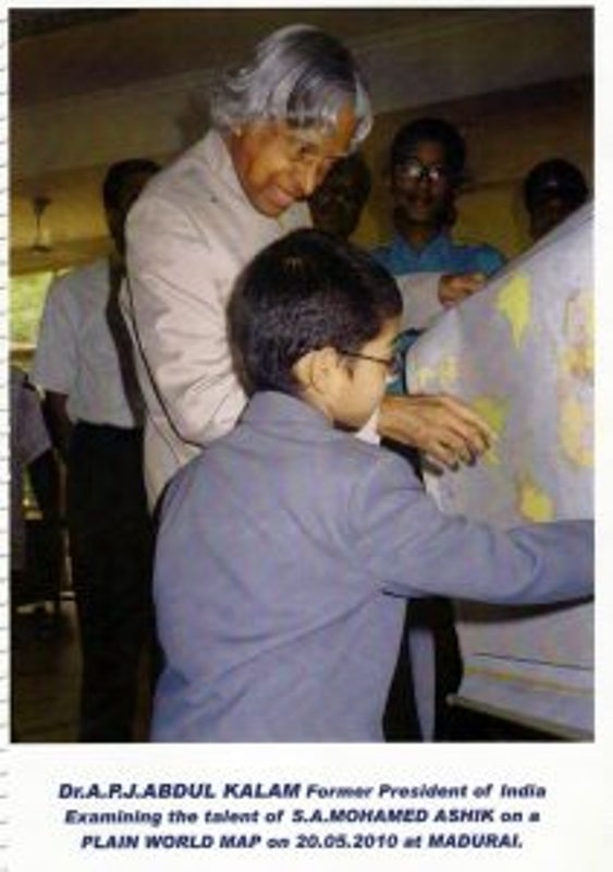 Dr A P J Abdul Kalam former president of India while examining the talent of S A Mohamed Ashik in 2010