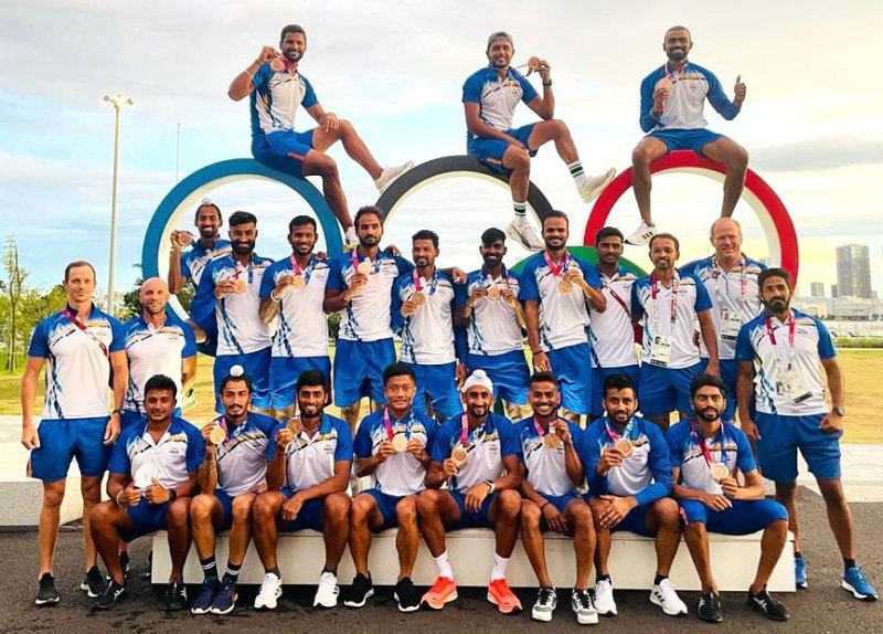 Indian men's team posing with the bronze medal at the 2020 Summer Olympics