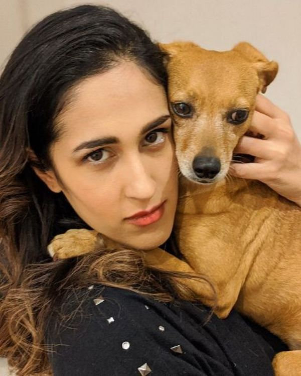 Mira Sethi holding her pet in her arms