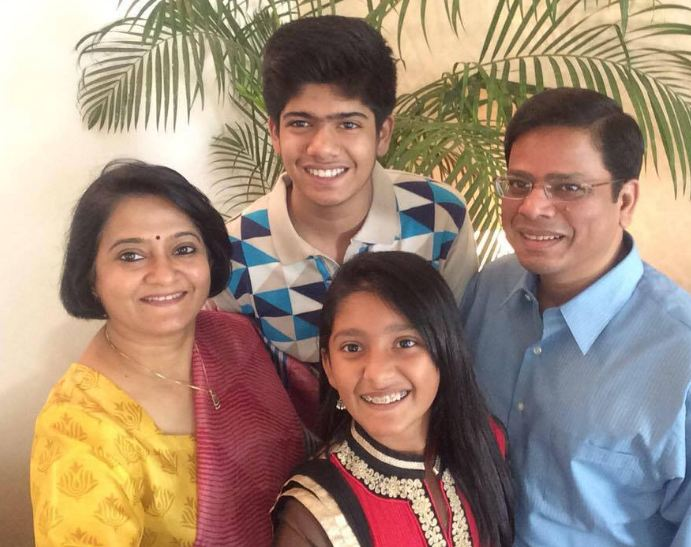 Rakesh Verma with his wife and children