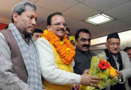 The senior leaders of BJP in Uttarakhand presenting a bouquet to Ajay Bhatt after he was appointed as the BJP Uttarakhand president