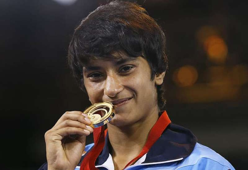 Vinesh Phogat while kissing her gold medal that she won at the 2014 Commonwealth Games in Glasgow