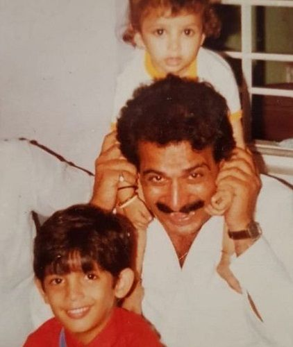 A childhood picture of Arjun Bijlani (in red T-shirt) with his father and brother