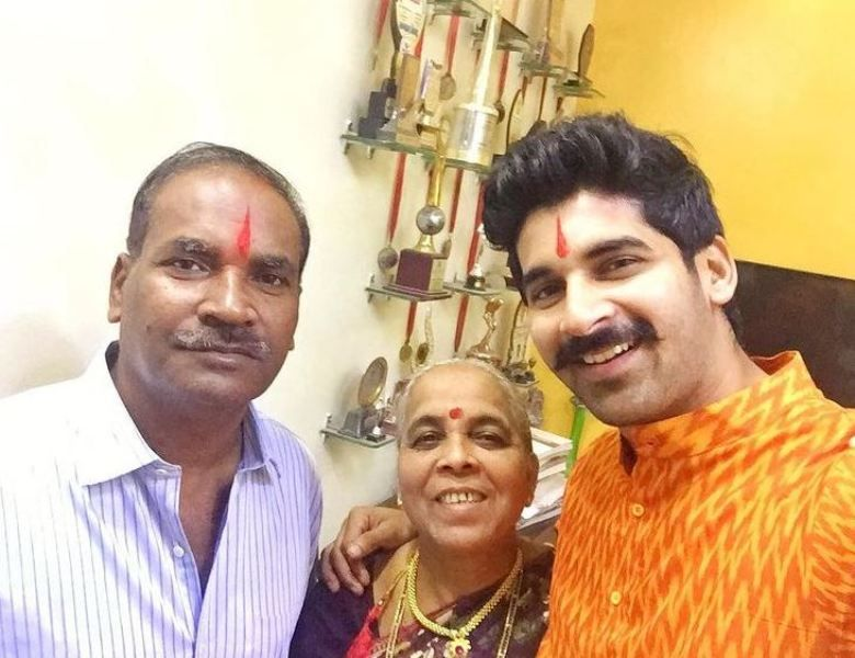 Akshay Waghmare with his parents