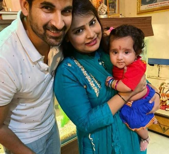 Akshay Waghmare with his wife holding her daughter
