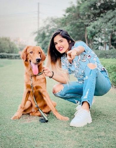 Ashima Chaudhary with her pet dog