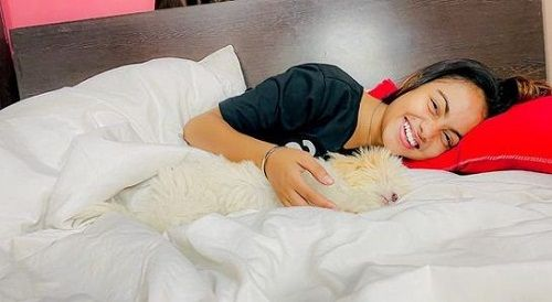 Beauty Khan with her pet dog
