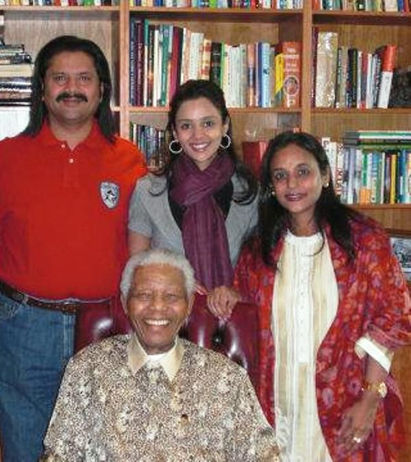 Gayatri Reddy with her parents and Nelson Mandela