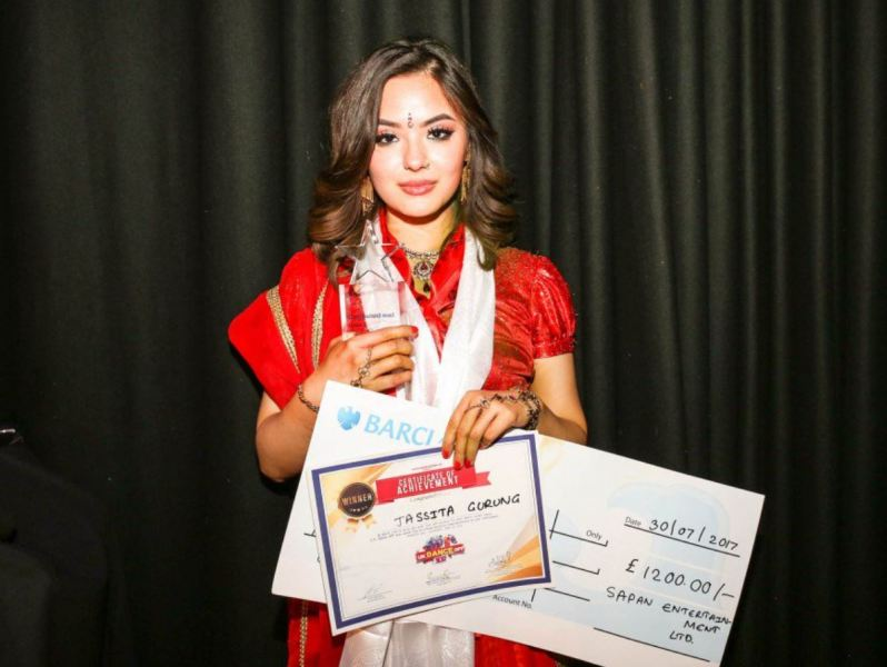 Jassita posing with her prizes after winning the dance competition in 2017