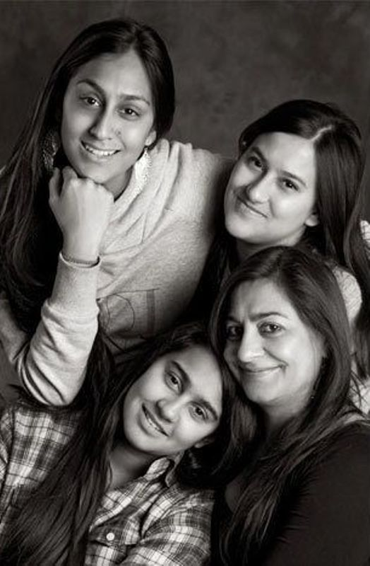 Karuna Ezara Parikh with her mother and two sisters