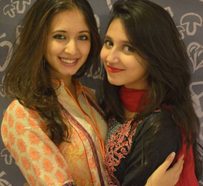 Komal Aziz Khan with her younger sibling
