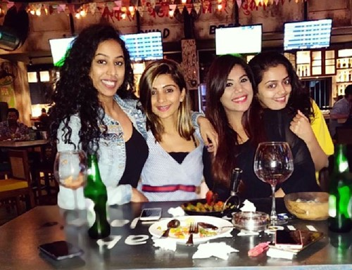 Meenal Shah (left) with her friends enjoying an alcoholic beverage