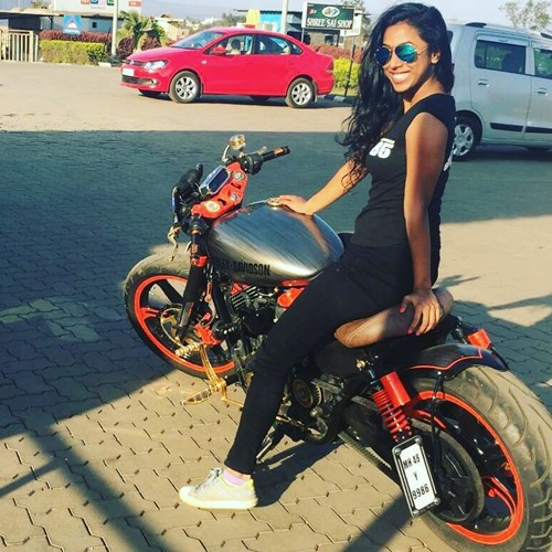 Meenal Shah posing with a customized Harley Davidson