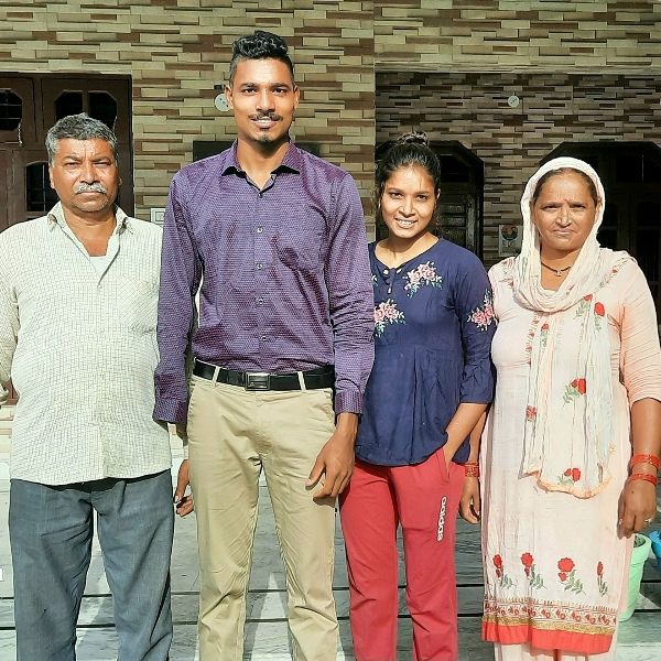 Nishad Kumar with his parents and sister