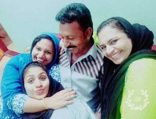 Noorin Shereef with her parents and sister