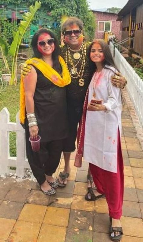 Santosh Chaudhary (Dadus) with his wife and younger daughter
