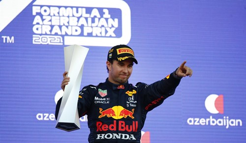 Sergio Perez with the F1 trophy after winning the 2021 Azerbaijan Grand Prix