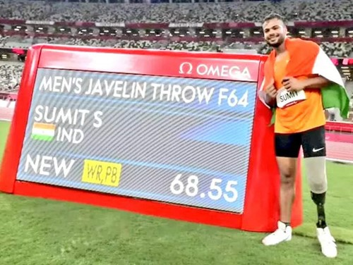 Sumit Antil with the scoreboard after making a world record in the 2020 Summer Paralympics