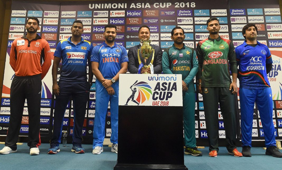 Teams posing with a trophy before the Asia Cup 2018
