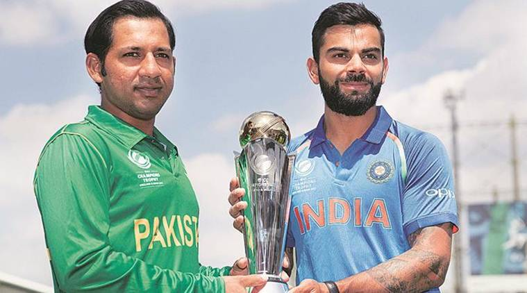Two captains posing with the trophy before the finals