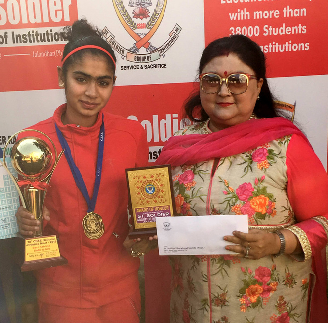 Harmilan Kaur with her school principal after winning the medal