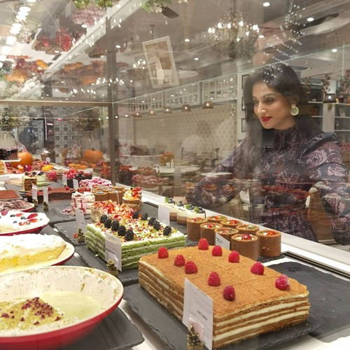 Donal Bisht looking at desserts in a shop
